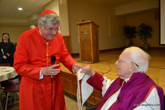 His Eminence Cardinal Collins giving me a 75th Ordination Anniversary vestment.