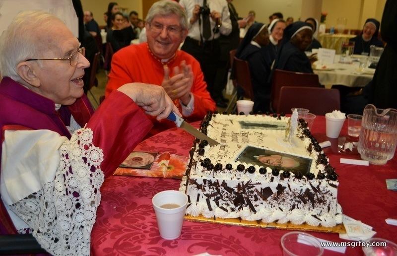 Enjoying cutting cake with Cardinal Colins