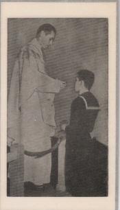 Fr Richard Ward giving Holy Communion